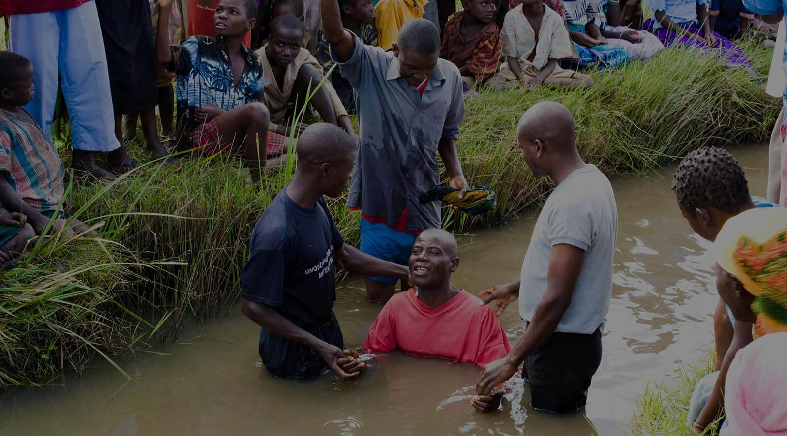 African baptism in river